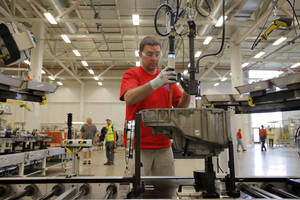 Photo - In this May 13, 2014 photo, Brian Moorman, of Russiaville, Ind., works on the line of a Chrysler transmission manufacturing facility in Tipton, Ind. The Conference Board reports on its index of leading economic indicators for April on Thursday, May 22, 2014. (AP Photo/AJ Mast)