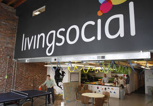 Photo - In this April 29, 2011 photo, Ross Arbes, 24, left, plays ping pong while on break at LivingSocial's offices in Washington.  Online deals company LivingSocial announced Thursday, Nov. 29, 2012, it is cutting 400 jobs worldwide, or about 9 percent of its work force, as the deals market continues to face challenges. (AP Photo/Jacquelyn Martin, File)