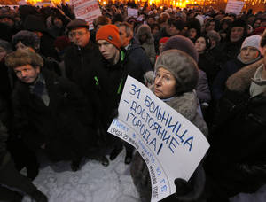 "Photo - A demonstrator holds a poster reading ""Hospital No. 31 is a city property"" during a protest against plans to shut down City Hospital No. 31 in St. Petersburg, Russia, Wednesday, Jan. 23, 2013. Some 1,500 thousand people gathered for a rally against plans to shut a clinic specialized in treating children with cancer in order to turn it into a medical center for the nation's top judges. The authorities intention to turn City Hospital No. 31 into a clinic that would exclusively serve judges of Russia's top courts, which are being relocated to St.Petersburg from Moscow, has caused a strong public dismay. On Wednesday, St.Petersburg Governor's office said that the hospital will continue to serve patients as before and there is no plan to change its location or profile.  (AP Photo/Dmitry Lovetsky)"