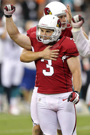 Photo -   Arizona Cardinals kicker Jay Feely (3) celebrates his winning field goal against the Miami Dolphins during overtime of an NFL football game, Sunday, Sept. 30, 2012, in Glendale, Ariz. The Cardinals won 24-21. (AP Photo/Paul Connors)