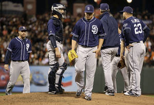 photo -   San Diego Padres' Andrew Werner, center, leaves the game against the San Francisco Giants in the fourth inning of a baseball game, Saturday, Sept 22, 2012, in San Francisco. (AP Photo/Ben Margot)