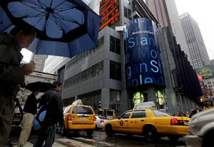 Photo - In this Wednesday, Oct. 10, 2012 photo, people pass Morgan Stanley's headquarters in New York. Morgan Stanley says it swung to a profit in the fourth quarter. Shares jumped in pre-market trading, Friday, Jan. 18, 2013. (AP Photo/Richard Drew)