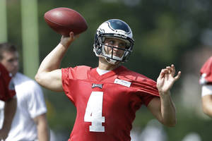 Photo - Philadelphia Eagles' G.J. Kinne throws a pass during the NFL football team's training camp in Philadelphia, Tuesday, July 23, 2013. (AP Photo/Matt Rourke) ORG XMIT: PAMR116