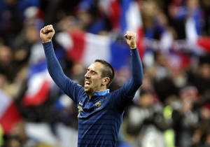 Photo - France's Franck Ribery raises his arms after the World Cup qualifying playoff second-leg soccer match between France and Ukraine at Stade de France stadium in Saint Denis, outside Paris, Tuesday, Nov. 19, 2013.  France beats Ukraine 3-0 in playoff second leg to qualify for World Cup. (AP Photo/Christophe Ena)