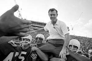 Photo -   FILE - In this Dec. 5, 1970, file phot, Texas coach Darrell Royal is carried from the field on the shoulders of his Longhorns following Texas' 42-7 triumph over Arkansas in Austin, Texas. Royal, who won two national championships and turned the Longhorns program into a national power, died early Wednesday, Nov. 7, 2012, at age 88 of complications from cardiovascular disease, school spokesman Bill Little said. Royal also had suffered from Alzheimer's disease. (AP Photo/File)
