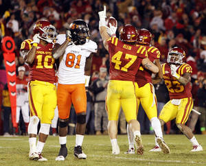 Photo - REACTION / INTERCEPT / INTERCEPTION: Iowa State players react after Ter'Ran Benton (22) intercepted a pass intended for Justin Blackmon (81) of OSU in double overtime during a college football game between the Oklahoma State University Cowboys (OSU) and the Iowa State University Cyclones (ISU) at Jack Trice Stadium in Ames, Iowa, Friday, Nov. 18, 2011. Iowa State won, 37-31, in double overtime. Photo by Nate Billings, The Oklahoman