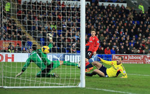 Photo - Sunderland's Steven Fletcher scores his team's opening goal during their English Premier League match against Cardiff City at the Cardiff City Stadium, Cardiff Wales Saturday Dec. 28, 2013.  (AP Photo/Nick Potts/PA) UNITED KINGDOM OUT