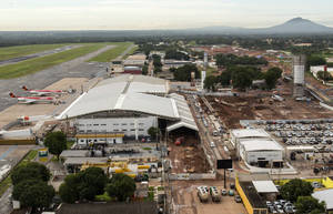 Photo - This Feb. 2014 photo released by Portal da Copa shows an aerial view of the Marechal Rondon International Airport still under construction in Cuiaba, Brazil. Infrastructure experts say that Brazil has run out of time to meet its promise to fully expand and renovate airports that will serve hundreds of thousands of fans pouring into the country for the World Cup that starts in just two months. Improvements are ready at only two of the 13 major airports that will be used in the tournament. (AP Photo/Portal da Copa, Jose Medeiro)