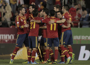 Photo - Spain's players celebrate after Xavi Hernandez, 2nd right scored during a 2014 World Cup Group I qualifying soccer match between Spain and Belarus at the  Iberostar Estadi in Palma de Mallorca, Spain, Friday Oct. 11, 2013. (AP Photo/Manu Mielniezuk)