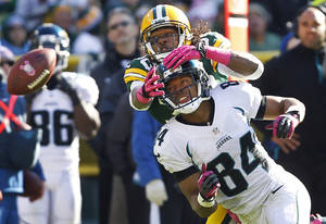 Photo -   Green Bay Packers cornerback Tramon Williams defends a pass intended for Jacksonville Jaguars wide receiver Cecil Shorts during the second half of an NFL football game, Sunday, Oct. 28, 2012, in Green Bay, Wis. The Packers won 24-15. (AP Photo/Mike Roemer)