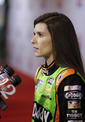 Photo - Driver Danica Patrick answers questions during  NASCAR auto racing media day at Daytona International Speedway in Daytona Beach, Fla., Thursday, Feb. 13, 2014. (AP Photo/John Raoux)