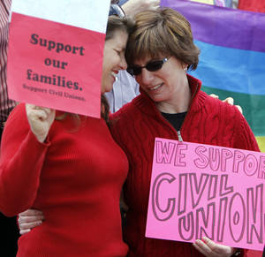 photo -   Partners Anna Simon, left, and Fran Simon embrace at a rally in support of Civil Unions at the Capitol in Denver on Tuesday, May 8, 2012. The rally pushed for the passage of a Civil Unions bill that must be debated on the House floor before it can be passed on Wednesday the final day of the Legislative session. (AP Photo/Ed Andrieski)