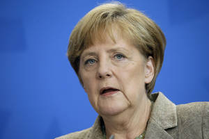 Photo - German Chancellor Angela Merkel speaks during a joint news conference with the Prime Minster of Moldova Iurie Leanca, as part of a meeting at the chancellery in Berlin, Germany, Thursday, July 10, 2014. (AP Photo/Michael Sohn)