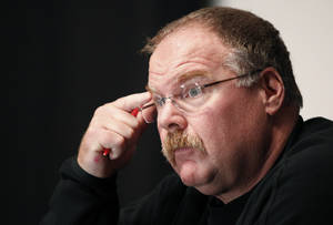 Photo - FILE - This Nov. 21, 2011 file photo shows Philadelphia Eagles head coach Andy Reid pausing while speaking during a media availability at their NFL football training facility in Philadelphia. Reid arrived in Kansas City on Friday, Jan. 4, 2012, and the Chiefs are close to making an official announcement that he will become their next coach.(AP Photo/Alex Brandon, File)