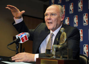 Photo - Denver Nuggets head coach George Karl makes a point to reporters during a news conference where he was named the NBA Coach of the Year, Wednesday, May 8, 2013, in Denver. (AP Photo/David Zalubowski)