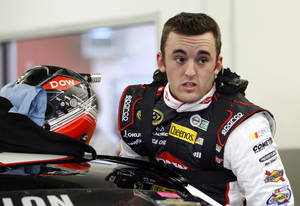 Photo - Austin Dillon climbs into his car before practice for Sunday's NASCAR Daytona 500 Sprint Cup Series auto race at Daytona International Speedway in Daytona Beach, Fla., Wednesday, Feb. 19, 2014. (AP Photo/Terry Renna)