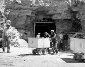 Photo - FILE - In this May 7, 1953, file photo, Navajo miners work at the Kerr McGee uranium mine at Cove, Ariz., on the Navajo reservation in Arizona. Kerr-McGee left abandoned uranium mine sites, including contaminated waste rock piles, in the Lukachukai mountains of Arizona and in the Ambrosia Lake area of New Mexico. The Lukachukai mountains are located immediately west of Cove, Ariz., and are a culturally significant part of the Navajo Nation. This site is among thousands that are part of the $5.15 billion settlement with Anadarko Petroleum Corp. with approximate amount of funding for cleanup efforts and details about the sites, in information provided by the Justice Department.  (AP Photo)