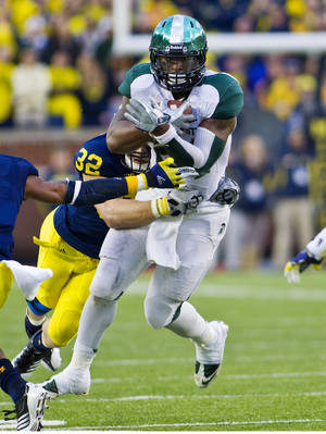 Photo -   Michigan State running back Le'Veon Bell (24) is tackled by Michigan safety Jordan Kovacs (32) in the fourth quarter of an NCAA college football game, Saturday, Oct. 20, 2012, in Ann Arbor, Mich. Michigan won 12-10. (AP Photo/Tony Ding)