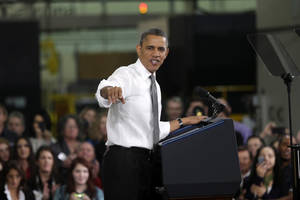 photo - President Barack Obama speaks at Linamar Corporation in Arden, N.C., the day after delivering his State of the Union address, Wednesday, Feb. 13, 2013. (AP Photo/Charles Dharapak)