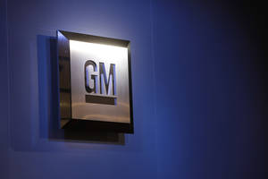 Photo -  The General Motors logo is on display at the North American International Auto Show in Detroit. AP File Photo  <strong>Paul Sancya -  AP </strong>