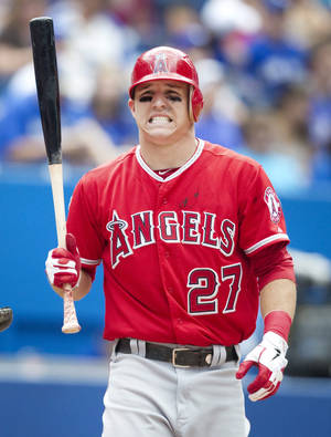 Photo -   Los Angeles Angels' Mike Trout grimaces at a called strike in the eighth inning of a baseball game against the Toronto Blue Jays in Toronto, Saturday, June 30, 2012. (AP Photo/The Canadian Press, Fred Thornhill)