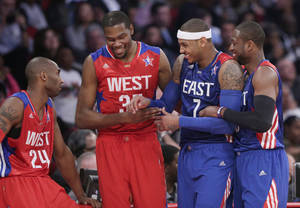 Photo - From left, West Team's Kobe Bryant, Kevin Durant, East Team's Carmelo Anthony and Dwyane Wade laugh during the first half of the NBA All-Star basketball game Sunday, Feb. 17, 2013, in Houston. (AP Photo/Eric Gay)