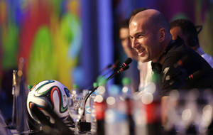 Photo - Former soccer great and World Cup winner Zinedine Zidane of France smiles during a press conference one day before the draw for the 2014 soccer World Cup in Costa do Sauipe near Salvador, Brazil, Thursday, Dec. 5, 2013. (AP Photo/Andre Penner)