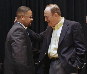 Photo - Former LSU coach Dale Brown, right, talks with Missouri coach Frank Haith, left, after Haith was given the U. S. Basketball Writers Association NCAA college basketball coach of the year award on Friday, March 30, 2012, in New Orleans. (AP Photo/Mark Humphrey) ORG XMIT: LAMH111