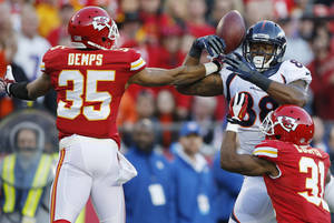Photo - Kansas City Chiefs defensive back Quintin Demps (35) breaks up a pass intended for Denver Broncos wide receiver Demaryius Thomas (88) during the first half of an NFL football game, Sunday, Dec. 1, 2013, in Kansas City, Mo. (AP Photo/Orlin Wagner)