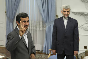 Photo -   FILE - In this Tuesday, Aug. 16, 2011 file photo, Iranian President Mahmoud Ahmadinejad, left, flashes a victory sign, as Iran's top nuclear negotiator Saeed Jalili, looks on, prior to their meeting with Russia's Security Council Secretary, Nikolai Patrushev, at the presidency office, in Tehran, Iran. Iran has made no secret of its hopes for the next round of nuclear negotiations with world powers: Possible pledges by the West to ease sanctions as a step toward deal making by Tehran. (AP Photo/Vahid Salemi, File)