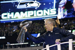 Photo - Seattle Seahawks head coach Pete Carroll holds the the Vince Lombardi Trophy after the NFL Super Bowl XLVIII football game against the Denver Broncos Sunday, Feb. 2, 2014, in East Rutherford, N.J. The Seahawks won 43-8. (AP Photo/Julio Cortez)