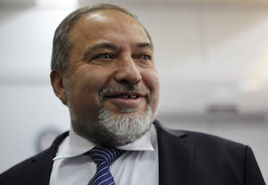 photo - Israel&#039;s hard-line former Foreign Minister Avigdor Lieberman, arrives at a Jerusalem court for the opening hearing of his trial on charges of fraud and breach of trust, Sunday, Feb. 17, 2013. Lieberman is accused of trying to advance the career of a former diplomat who relayed information to him about a since-closed criminal investigation into his business dealings. (AP Photo/Ariel Schalit)