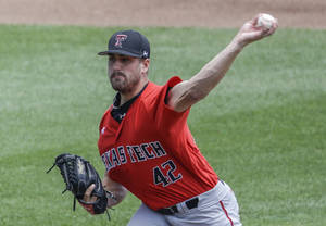 Photo - Texas Tech pitcher Chris Sadberry (42) delivers against TCU in the first inning of an NCAA baseball College World Series game in Omaha, Neb., Sunday, June 15, 2014. (AP Photo/Nati Harnik)