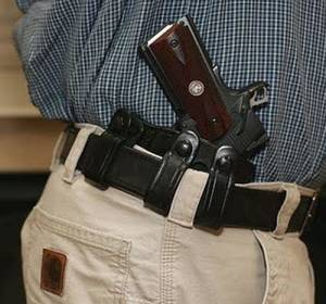 Photo - OPEN CARRY GUN LAW  / HANDGUN    ORG XMIT: 1206211913105227