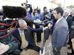 Photo - Muneer Awad, executive director of Council on American-Islamic Relations in Oklahoma, talks to media in Oklahoma City today. Photo by Steve Gooch