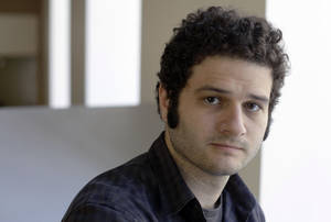 Photo -   FILE-In this Thursday April 26, 2012, file photo, Dustin Moskovitz co-founder of the collaborative software company Asana, poses outside of his office in San Francisco. Facebook co-founder Dustin Moskovitz has been selling 150,000 shares of Facebook stock a day out of the hundreds of millions that he owns. So far, he has shed 1.35 million shares for proceeds of $26.2 million, at prices ranging from $18.79 to $20.08. (AP Photo/Eric Risberg)