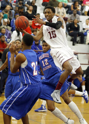 photo - Northeast's Rodney Overton shoots a layup in between Millwood's Quincy Dotson and London Potts during the boy's basketball game between Northeast  and Millwood at Northeast,  Tuesday,Jan. 8, 2013. Photo by Sarah Phipps, The Oklahoman