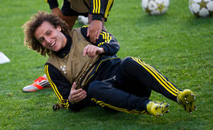 Photo -   Chelsea's David Luiz laughs during a training session at the Stamford Bridge stadium, London, Tuesday, Sept. 18, 2012. Chelsea will face Juventus in a Champions League group E soccer match at the Stamford Bridge stadium, London, Wednesday. (AP Photo/Tom Hevezi)
