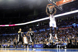 photo - Oklahoma City Thunder's James Harden (13) dunks in front of San Antonio Spurs' Daniel Green (4) and Kawhi Leonard (2) during the NBA basketball game between the Oklahoma City Thunder and the San Antonio Spurs at the Chesapeake Energy Arena in Oklahoma City, Sunday, Jan. 8, 2012. Photo by Sarah Phipps, The Oklahoman