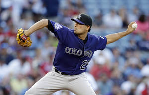 Photo - Colorado Rockies starting pitcher Jorge De La Rosa (29) works in the first inning of a baseball game against the Atlanta Braves in Atlanta, Monday, July 29, 2013. (AP Photo/John Bazemore)