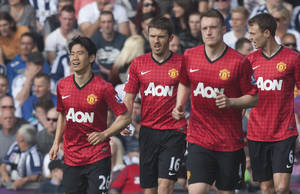 Manchester United's Shinji Kagawa, left, celebrates scoring against West Bromwich Albion with teammates during their English Premier League soccer match at The Hawthorns Stadium, West Bromwich, England, Sunday May 19, 2013. (AP Photo/Jon Super)