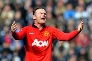 Photo - FILE - This is a Saturday, March 8, 2014 file photo of  Manchester United's Wayne Rooney as he  shouts instructions to teammates during the English Premier League soccer match between West Bromwich Albion and Manchester United at The Hawthorns Stadium in West Bromwich, England. Manchester United on Monday July 14, 2014 secured the most lucrative kit deal in football, announcing that Adidas has agreed to pay $1.3 billion over 10 years to take over the sponsorship from Nike. The deal, worth 75 million pounds ($128 million) a year from 2015, was announced after Nike decided that trebling the cost of its existing 13-year equipment supply contract was not good value for the company.  (AP Photo/Rui Vieira, File)