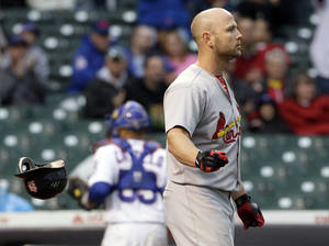 photo -   St. Louis Cardinals' Matt Holliday throws his helmet after striking out in the 11th inning of a baseball game against the Chicago Cubs in Chicago, Friday, Sept. 21, 2012. The Cubs won 5-4. (AP Photo/Nam Y. Huh)
