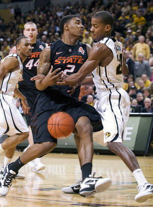 photo - Missouri's Kim English, right, knocks the ball away from Oklahoma State's Le'Bryan Nash (2) as Missouri's Matt Pressey, left, and Oklahoma State's Philip Jurick (44) look on during the first half of an NCAA college basketball game Wednesday, Feb. 15, 2012, in Columbia, Mo. (AP Photo/L.G. Patterson) ORG XMIT: MOLG102