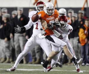 photo - Oklahoma's Tony Jefferson (1) and Demontre Hurst (19) break up a pass intended for Oklahoma State's Bo Bowling (9) during the Bedlam college football game between the University of Oklahoma Sooners (OU) and the Oklahoma State University Cowboys (OSU) at Boone Pickens Stadium in Stillwater, Okla., Saturday, Nov. 27, 2010. Photo by Sarah Phipps