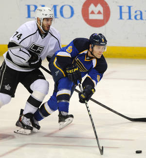 Photo - St. Louis Blues' Jaden Schwartz (9) passes in front of Los Angeles Kings' Dwight King (74) during the second period of an NHL hockey game on Thursday, Jan. 2, 2014 in St. Louis. (AP Photo/Bill Boyce)