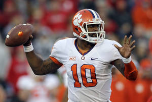 Photo - Clemson quarterback Tajh Boyd throws to a receiver in the second half of an NCAA college football game against Maryland in College Park, Md., Saturday, Oct. 26, 2013. (AP Photo/Patrick Semansky)