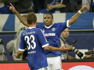 Photo - Schalke's Jefferson Farfan , right, celebrates after scoring a penalty goal during the German soccer Bundesliga match between FC Schalke 04 and Bayer Leverkusen at the arena in Gelsenkirchen, Germany, Saturday, Aug. 31, 2013. (AP Photo/Martin Meissner)