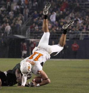 Photo - OSU's Zac Robinson is brought down during the Holiday Bowl college football between Oklahoma State and Oregon at Qualcomm Stadium in San Diego, Tuesday, Dec. 30, 2008. PHOTO BY BRYAN TERRY
