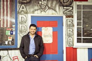 """Photo - This undated photo provided by the Travel Channel shows host Adam Richman of the new series, """"Man Finds Food"""" in Atlanta.  The channel said Tuesday, July 1, 2014, that Richman's show has been postponed indefinitely but didn't explain why. """"Man Finds Food"""" was to debut Wednesday. (AP Photo/Travel Channel, Gabriela Herman)"""